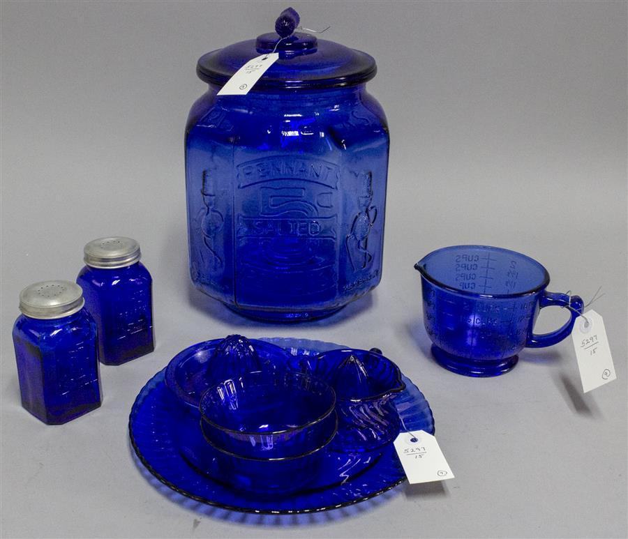 Nine pieces of cobalt blue glass including a Mr