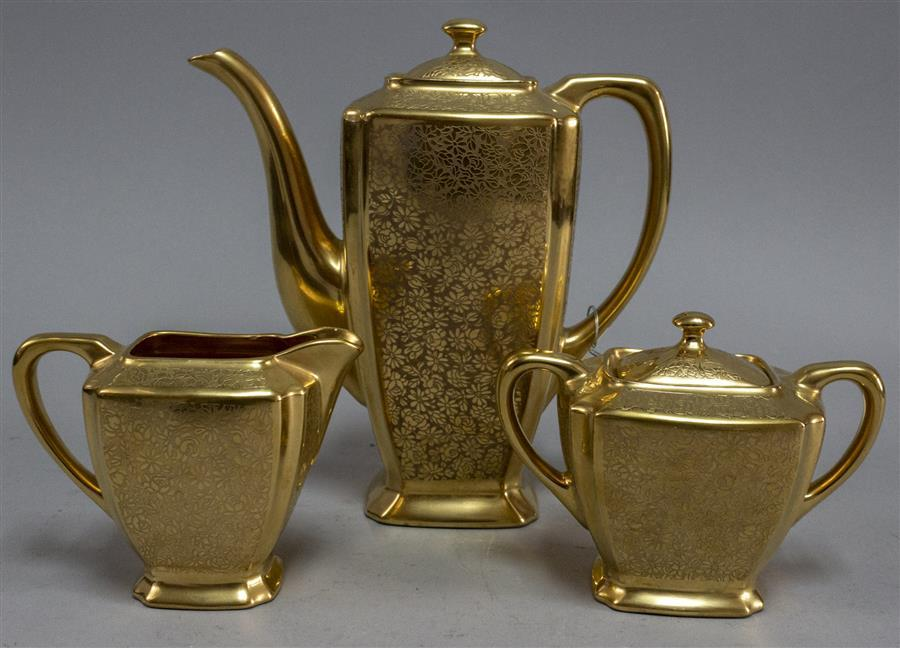 Three piece coffee and tea service, gold finish