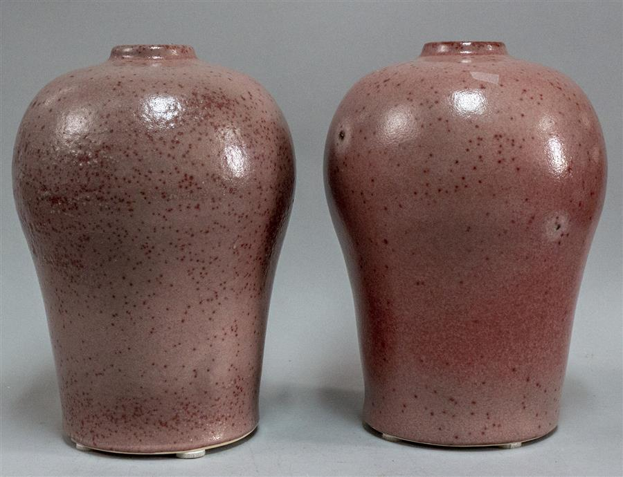 Pair of speckle glazed pottery vases.