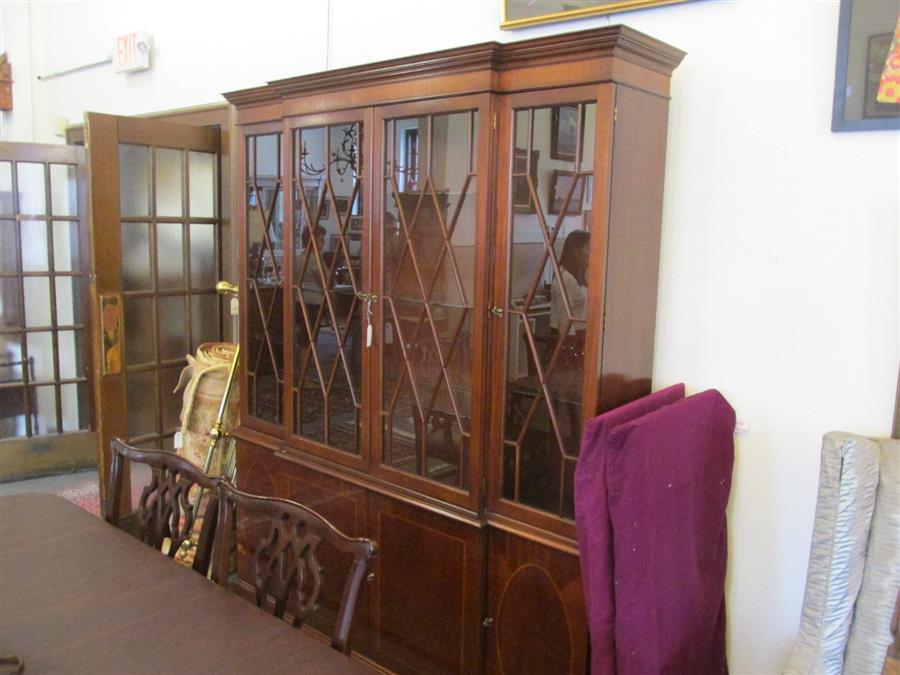 English design two member breakfront china cabinet having four glazed doors above four cupboard doors