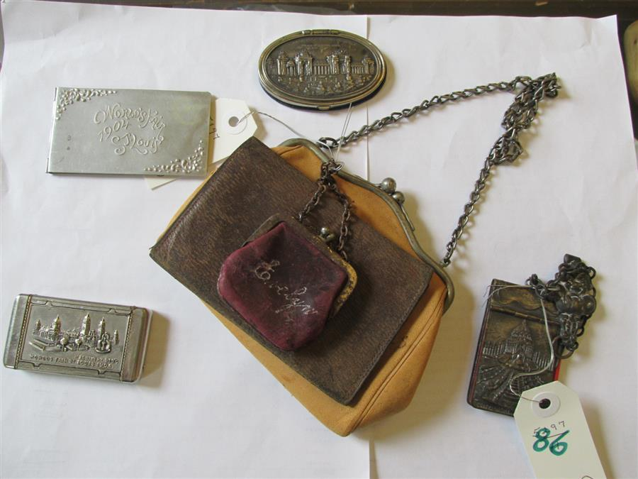 Collection of 1904 World's Fair items including a silver match box, a heavy metal notepad with pencil, a coin purse, other leather p..
