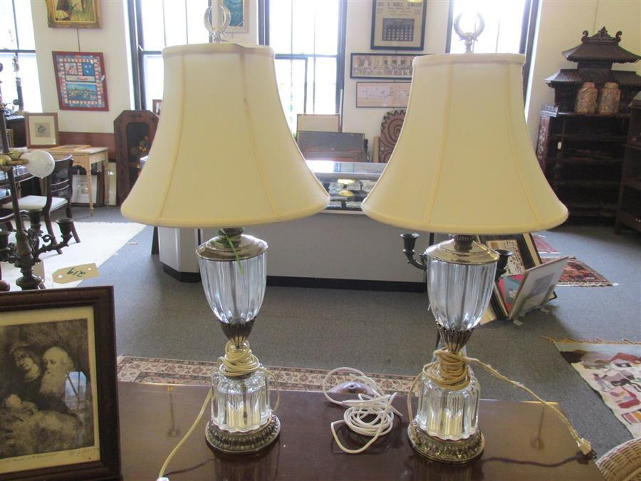Pair of silver plated and crystal lamps