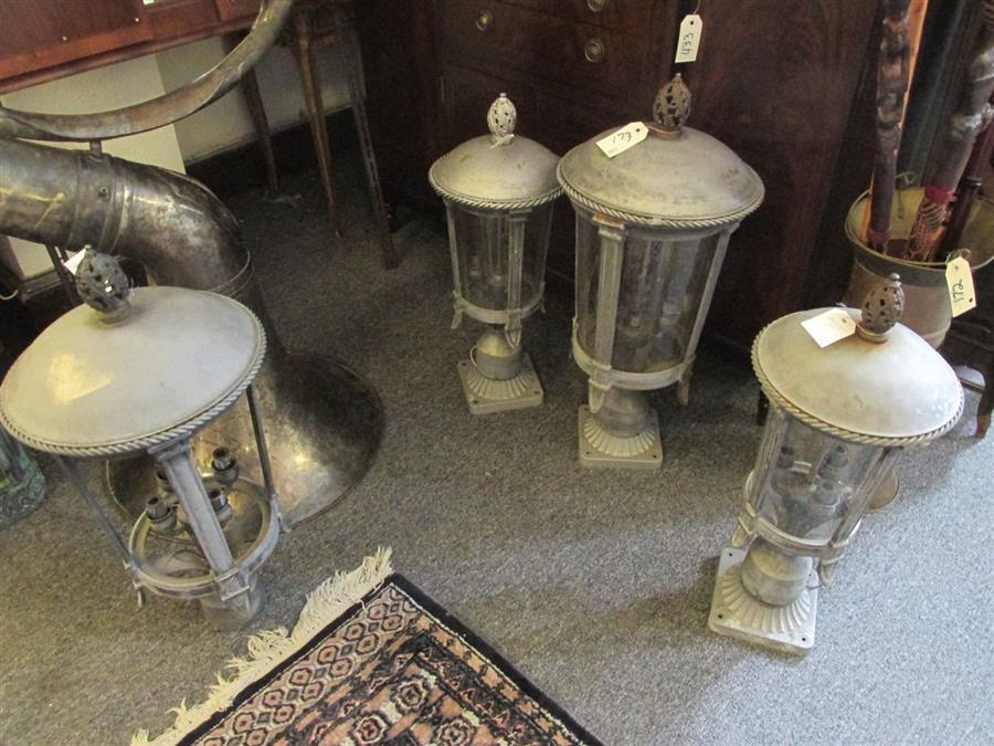 Four electrified lamp post lanterns with decorative finials
