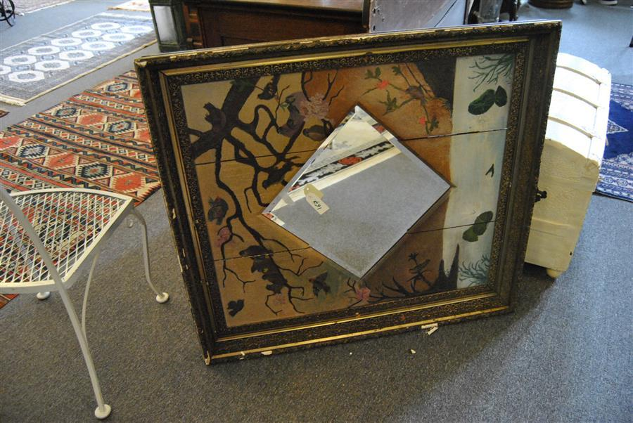 Diamond shaped beveled edged mirror in an antique gold gilt frame surrounded by a hand painted scene of birds