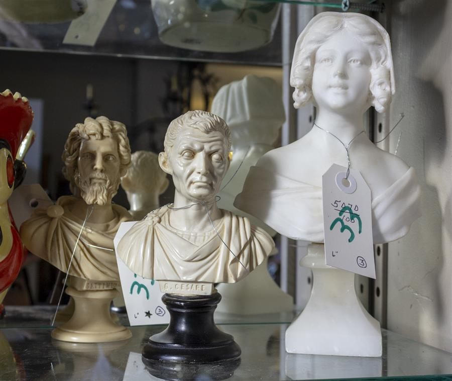 Two composition busts of classic figures (height: 6 inches each) and an alabaster bust statue of a young woman (height: 8 1/2 inches)