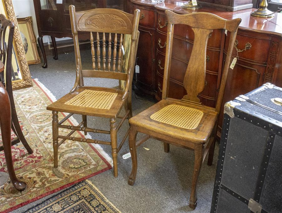 Two wooden side chairs, both with caned seats