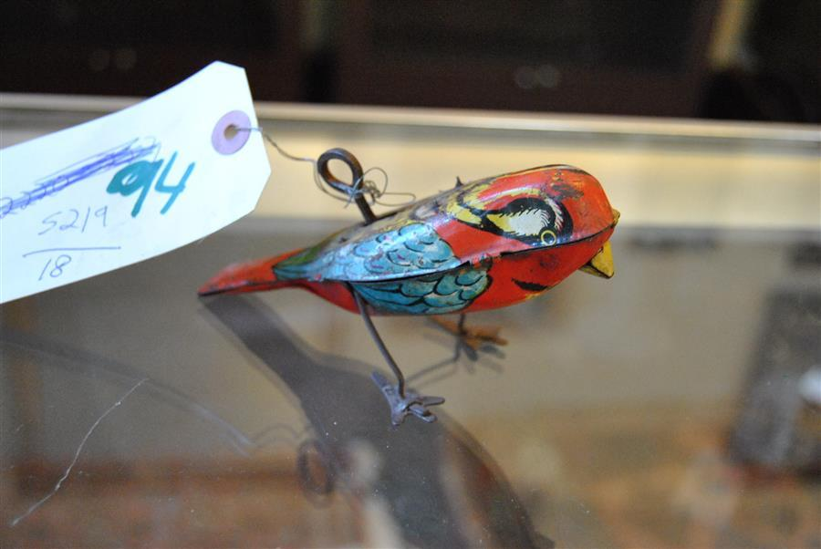 Lindstrom tin litho key wind-up bird, marked Lindstrom U