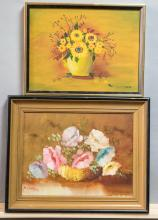 Two framed oil paintings on canvas depicting floral bouquets, each painting artist signed