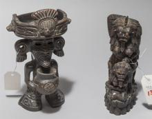 Two statues one featuring a figure from Southeast Asia (8 inches) and the other statue of an Aztec god (9 inches)