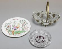 Pressed glass ashtray with bird motif to the middle, a Royal Worcester plate, a glass bowl within a plated silver basket