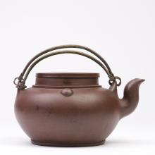 A Yi Xing Zisha Teapot with Swing Handles