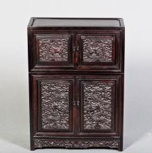A 'DRAGON' HARDWOOD CABINET