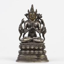 A SILVER AND GOLD-INLAID FIGURE OF FOUR ARMS AVALOKITESHVARA, QING DYNASTY
