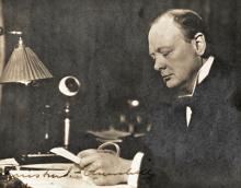 Signed Photograph of Winston Churchill Seated at his Desk