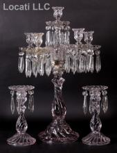 Two Candlesticks and a Girandole Att. to Baccarat