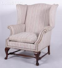 A Queen Anne Style Wing Back Easy Chair