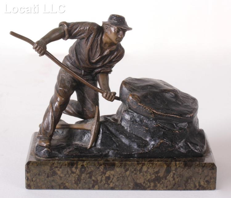 A Small Bronze Figure of a Prospector