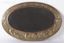 An Art Nouveau Brass Repousse Mirror, Manner of Marion Henderson Wilson (Scottish 1869 - 1956)