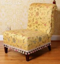 An Upholstered Slipper Chair by Baker