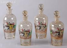 A Set of Four Czech Glass Hand Painted Decanters
