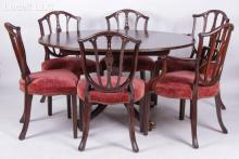 A Baker Historic Charleston Reproduction Mahogany Dining Table with Six Chairs