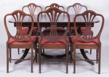A Mahogany Double Pedestal Dining Table and Six Sheraton Style Chairs