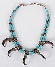 A Navajo Silver, Turquoise and Bear Claw Necklace