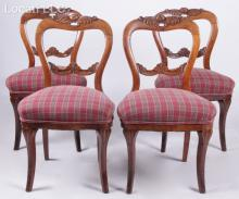 A Set of Four Victorian Walnut Side Chairs
