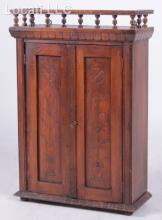 An Aesthetic Movement Walnut Hanging Cabinet
