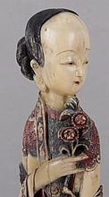 A Chinese Polychrome Decorated Ivory Figure of an Immortal