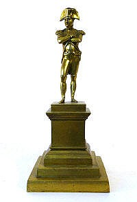 A brass figure of Napoleon modelled standing on a
