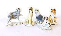 Five Royal Worcester models of dogs comprising