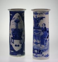 A Chinese Blue and White vase. Of tapering cylindrical form. Painted with figures in a garden. With underglaze blue four character marks. 26cm high. In good condition. Possibly Jiaqing (1796-1820). Together with a second vase, circa 1900.25cm high.