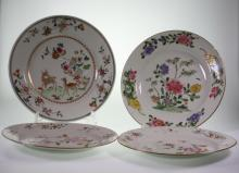 Two Chinese Export Shallow dishes and Two Plates. 18th century. Each decorated with flowers. Minor chips to rim.Each about 23cm diameter. (4)