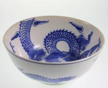 A Chinese Blue and White Bowl. 19th century. Decorated with Dragons chasing flaming pearls. With underglaze blue four chracter mark. 8cm high. 18cm diameter.