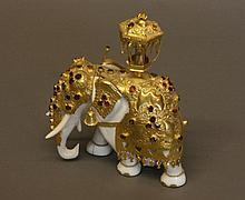 A Fine Indian Ivory, Silver Gilt and Garnet Set