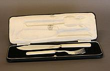 A Pair of George VI Fish Servers. With ivory