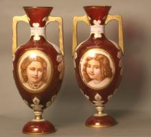 Near Matching Pair of Bohemian Ruby Glass Two Handled Vases