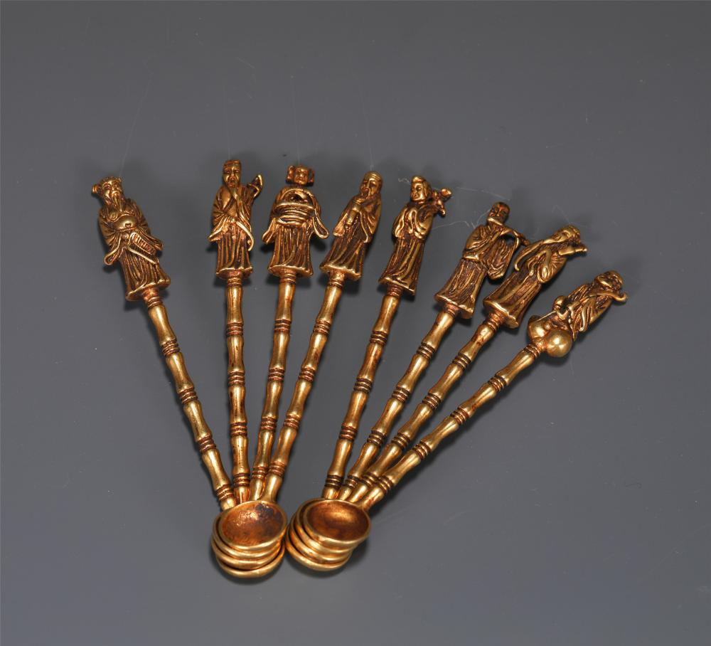 A SET OF CHINESE GILT BRONZE EIGHT IMMORTALS HANDLE SPOONS
