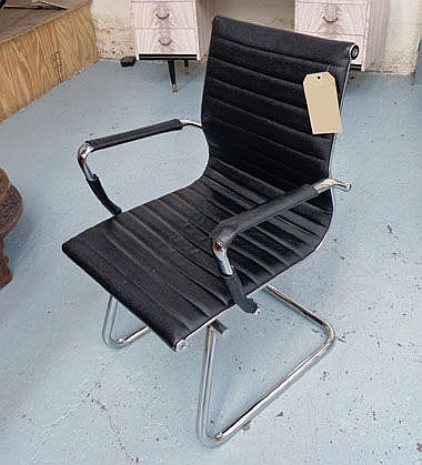 EASY CHAIR, Eames style, in black ribbed leather,