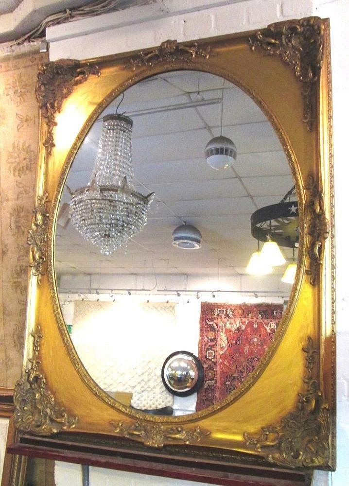 Wall mirror 19th century style with oval plate within a rec for Lots of pictures on wall