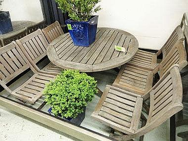 GARDEN TABLE, weathered teak with round top and a