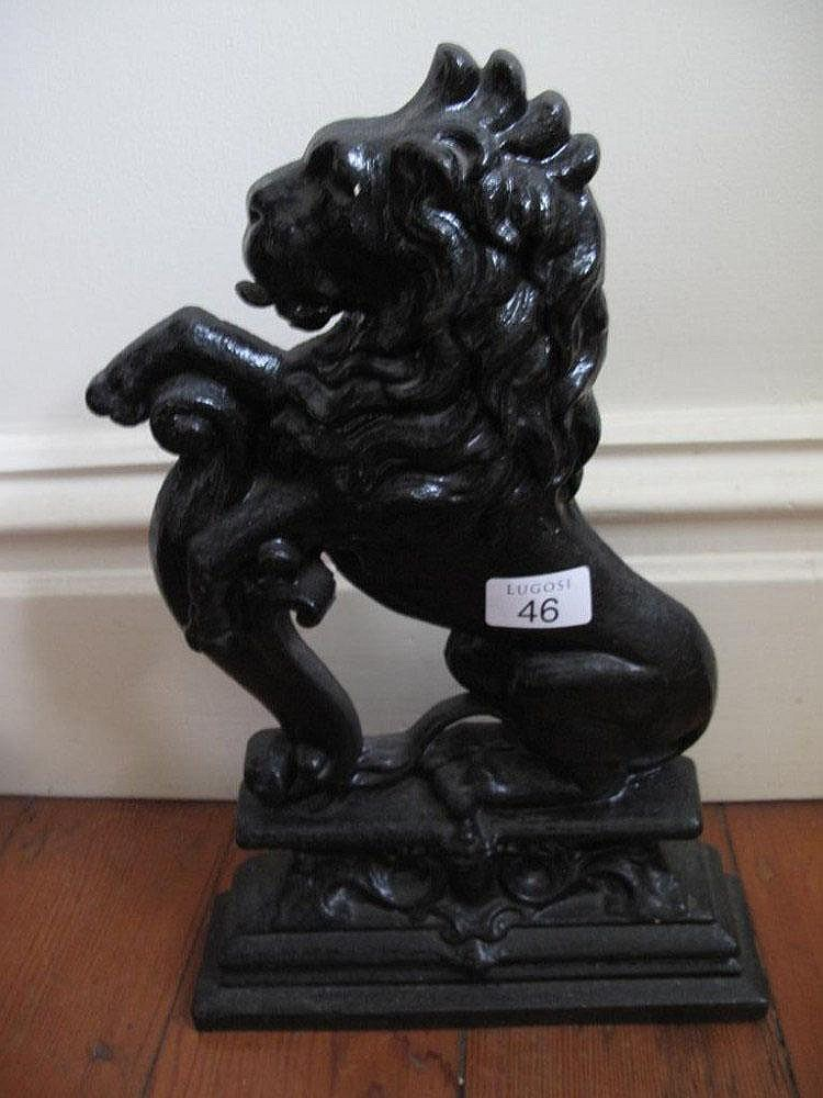 Large antique cast iron lion doorstop