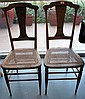 Pair of antique elm chairs with caned seats
