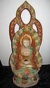 Unusual Chinese Sancai Glazed Buddha holding an