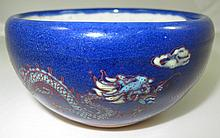Oriental cobalt blue glazed bowl with dragons