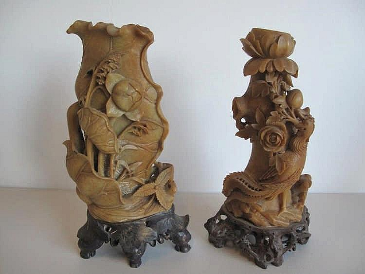 Two Chinese carved shoushan vases on stands carved with lotus flowers the o