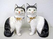 Pair antique bisque black & white cat figures