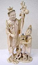 Fine Meiji ivory Okimono man with monkey Shibayama inlays to Monkeys robe t