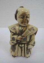 Antique netsuke of a man holding a fan with moveable head signed 6.5cms Ht